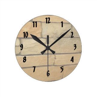 block wall overlay orangy color round clock