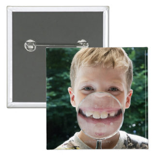 blond boy behind magnifying glass smiling 2 inch square button