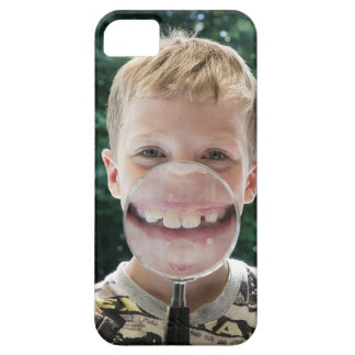 blond boy behind magnifying glass smiling iPhone SE/5/5s case