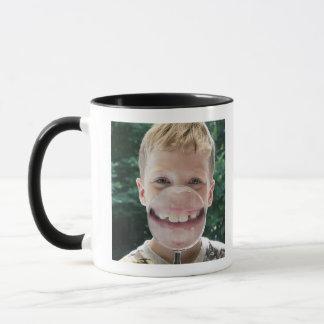 blond boy behind magnifying glass smiling mug