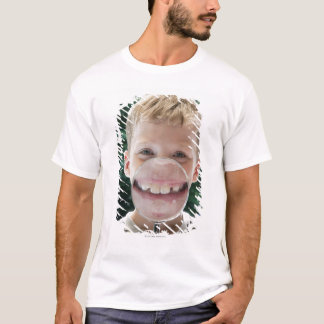 blond boy behind magnifying glass smiling T-Shirt