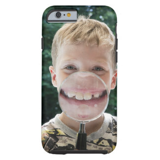 blond boy behind magnifying glass smiling tough iPhone 6 case