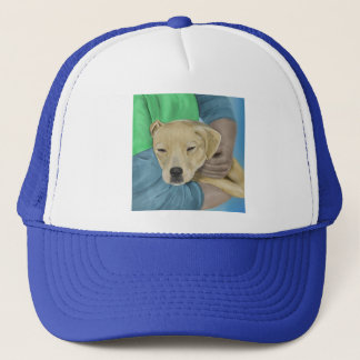 Blond Dog is Being Cradled by a Person Trucker Hat