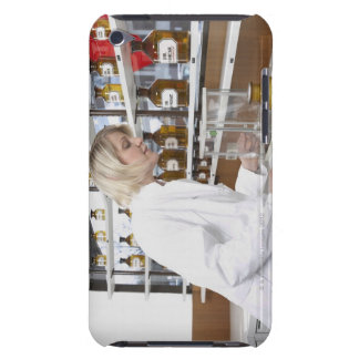 Blond pharmacist working in lab and smiling into barely there iPod covers
