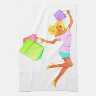 Blonde fashion model holding shopping bags towels