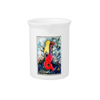 blonde mermaid in red drink pitcher