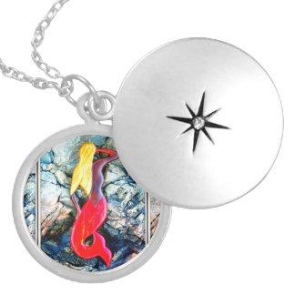 blonde mermaid in red locket necklace