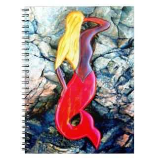 blonde mermaid in red spiral notebook