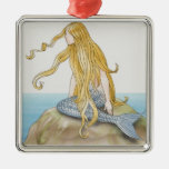 Blonde mermaid sitting on sea rock, side view. square metal christmas ornament