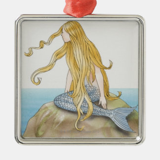 Blonde mermaid sitting on sea rock, side view. square metal christmas ornament