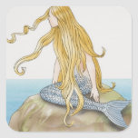 Blonde mermaid sitting on sea rock, side view. square sticker