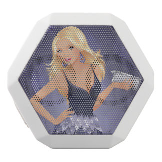 Blonde model holding purse in navy blue dress white bluetooth speaker