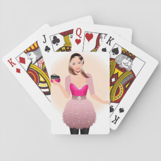 Blonde model in pink and white dress holding a pur playing cards