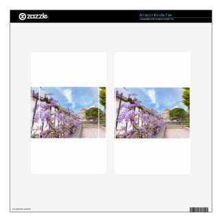 Blooming blue Wisteria sinensis on fence in Greece Kindle Fire Skin