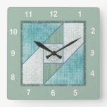 Bloque del edredón de la ventana del ático en azul relojes
