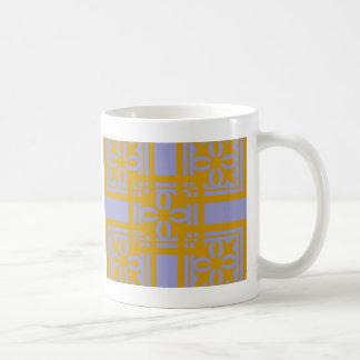 Bloques del diseño del oro taza