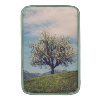 Blossom tree on A hill in Switzerland MacBook Sleeve