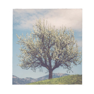 Blossom tree on A hill in Switzerland Notepad