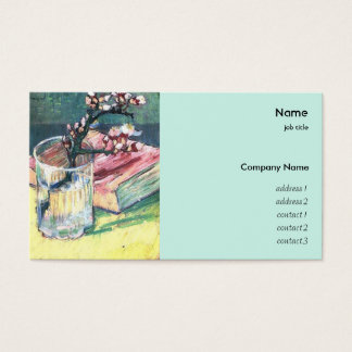Blossoming almond branch in a glass with a book business card
