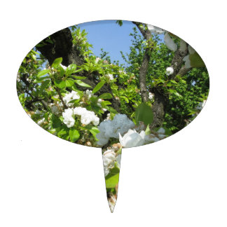 Blossoming branches of a pear tree in spring cake topper