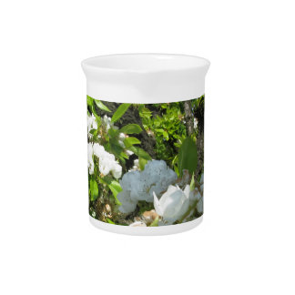 Blossoming branches of a pear tree in spring drink pitcher