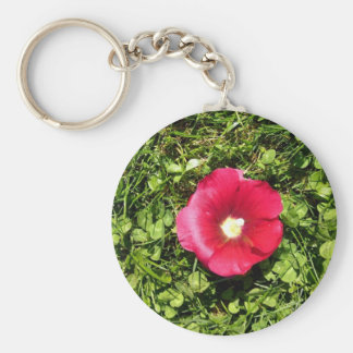 Blossoming Red flower in green leaf texture Keychains
