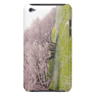 Blossoming Yoshino cherry trees in a field of Barely There iPod Case