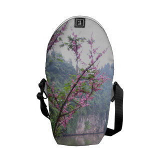 Blossoms over lake courier bags