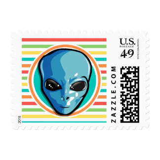 Blue Alien on Bright Rainbow Stripes Stamps