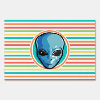 Blue Alien on Bright Rainbow Stripes Yard Sign