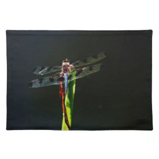 Blue and black Dragonfly on green and red grass Placemats