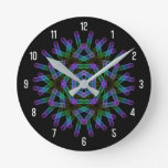 Blue and green geometric figures round clock