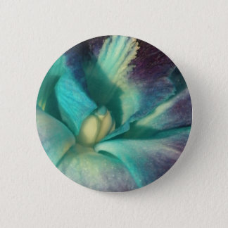 Blue and purple orchid close up button