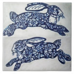 """Blue and White Rabbit Marble Look Ceramic Tile<br><div class=""""desc"""">My blue and white running rabbit paintings were done on beautiful white marble,  and combined on this ceramic tile.</div>"""