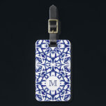 """Blue and White Watercolor Spanish Tile Monogram Luggage Tag<br><div class=""""desc"""">Our breezy Mediterranean blue and white monogram luggage tag makes it easy to spot your bag on the carousel! Design features a classic Spanish tile pattern in cobalt blue and white watercolors. Add a single initial monogram to the front, and your full contact details on the reverse side. To maintain...</div>"""