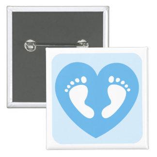 Blue baby boy feet or footprints in heart button