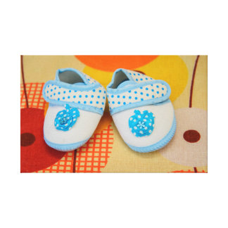 Blue baby shoes gallery wrapped canvas