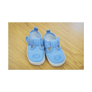 Blue baby shoes stretched canvas print