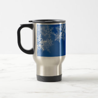 Blue background with snow flakes. travel mug