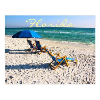 Blue beach chairs in florida postcard