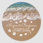 "Blue Beach Waves and Sand Romantic Summer Wedding Classic Round Sticker<br><div class=""desc"">Blue crystal clear sea water and seaside sand wedding stickers. Please use the 'customize' button to edit font style or move sea treasures.</div>"