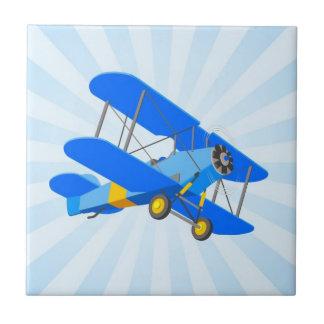 Blue Biplane Graphic with Star Burst Ceramic Tiles
