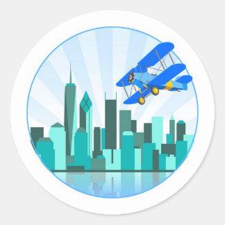 Blue Biplane Over New York Retro Design Classic Round Sticker