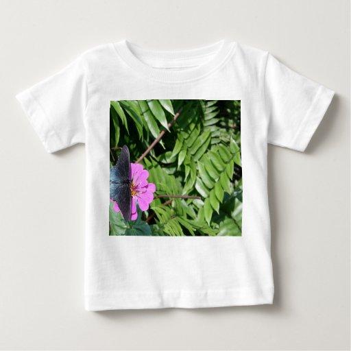 Blue black butterfly on purple flower, green leaf t-shirt