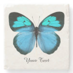 Blue Butterfly Custom Stone Coaster<br><div class='desc'>Pretty stone coaster with digital graphics of a blue,  black,  and turquoise blue butterfly.  Black text reads whatever you want it to say.  Makes a lovely gift idea.</div>