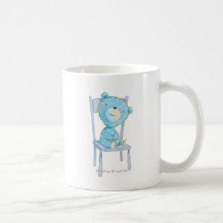 Blue Calico Bear Smiling on Chair Coffee Mug