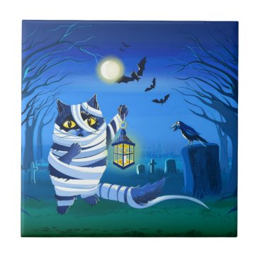 Halloween Themed Blue cat dressed as a Mummy on the graveyard Ceramic Tile