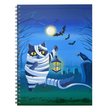 Halloween Themed Blue cat dressed as a Mummy on the graveyard Notebook