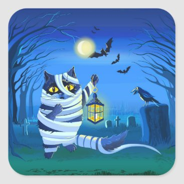 Halloween Themed Blue cat dressed as a Mummy on the graveyard Square Sticker