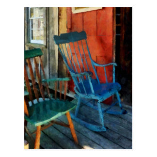 Blue Chair Against Red Door Postcard